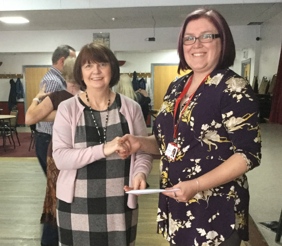 Janinna Mossman of Nene School Of Dancing presenting cheque to Tammy Swiderski of East Anglian Air Ambulance
